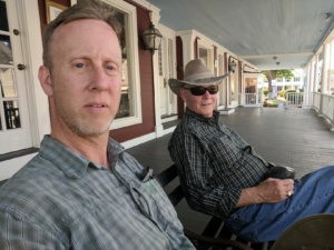 hubby and pop relaxing on a bench in rockport, ma