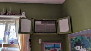the completed ac box cover in the living room with doors open