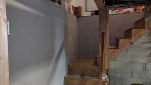 i painted drylok masonry waterproofer on the walls going up the basement stairs