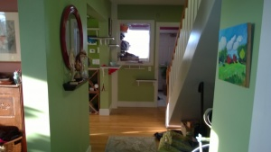 view of the downstairs hall towards the laundry room