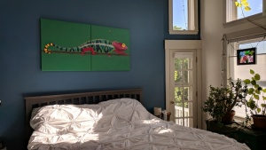the chameleon mural looks wonderful hung over our bed