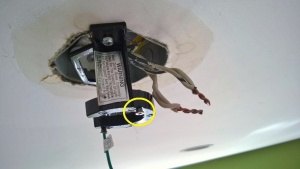 old photo showing screw from when i first installed the bedroom ceiling fan