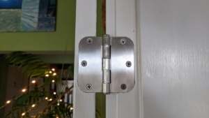the silver nickel colored hinges in the french doors in the living room