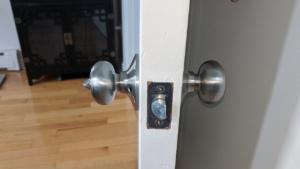 the silver nickel colored doorknob in the master bedroom/bath door