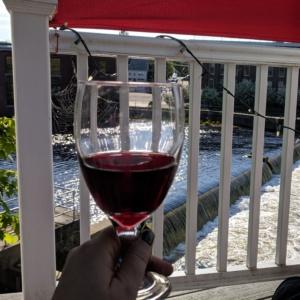 enjoying wine on the deck overlooking the ipswich river