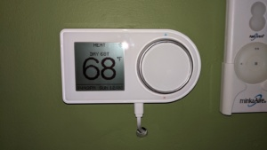our new living room lux geo smart thermostat with usb cable