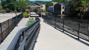 a view of the ipswich riverwalk from the bridge
