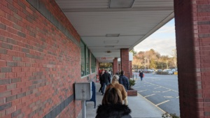 the new normal - waiting in line to enter market basket rowley