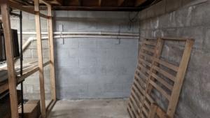 one coat of grey drylok waterproofing sealant on the basement wall