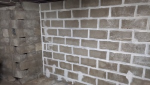i edged the large basement wall with a brush before painting sealant