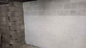 painting the 2nd coat of drylok waterproofing sealant on the basement wall