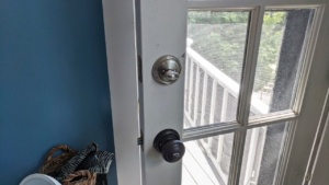 the baldwin smartkey deadbolt & doorknob in the bedroom door - silver nickel brass