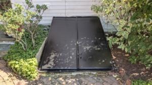 our basement bulkhead after 2 coats of exterior black paint