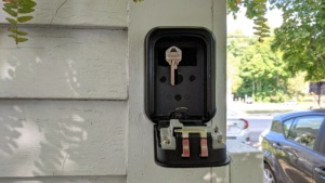 i used adhesive velcro strips to hang the spare key in the lockbox