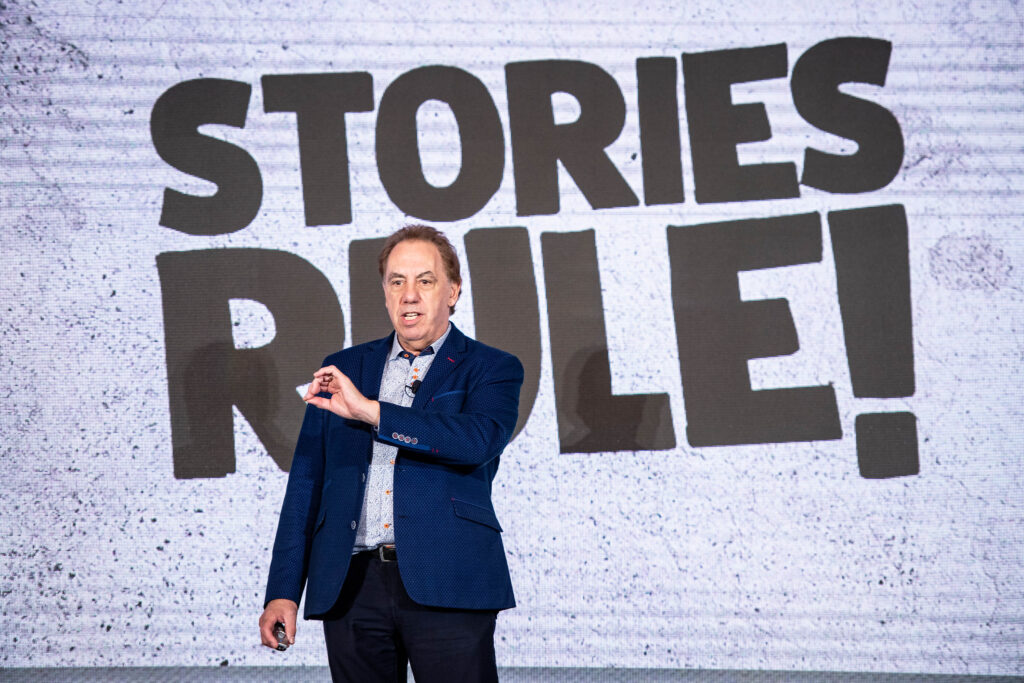 Doug Keeley Speaks on stage talking about why Stories Rule! for the blog