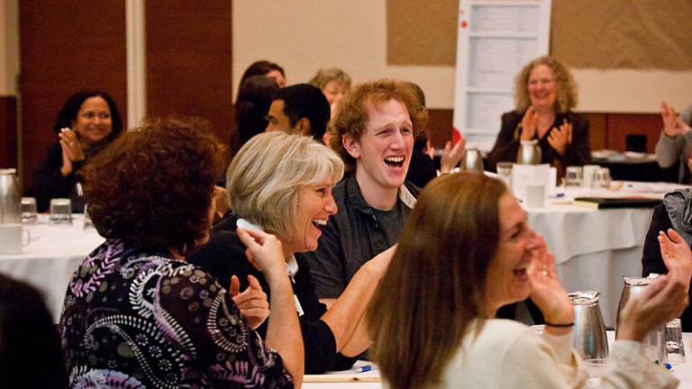 Laughing audience taking in corporate storytelling training