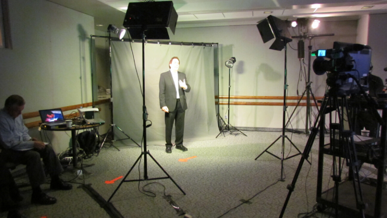 Doug shooting virtual keynote speaker content
