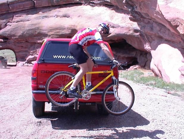 Evan on bike on rackstand