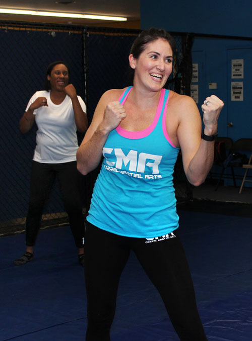 Students at a Women's Self-Defense class practicing boxing