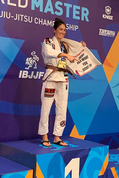 Brianne Corral on the podium at the IBJJF World Master brazilian jiu-jitsu tournament