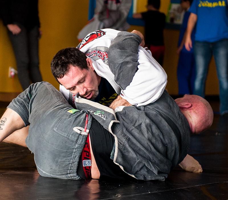 BJJ black belts rolling at Corral's Martial Arts