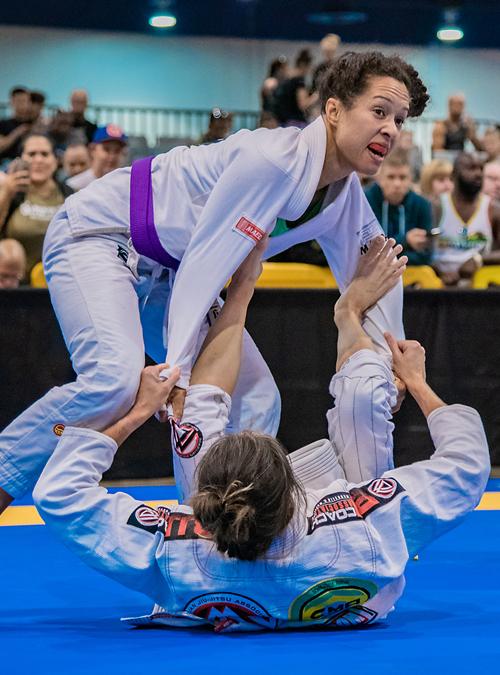 Women's Self-Defense instructor fighting at an IBJJF tournament