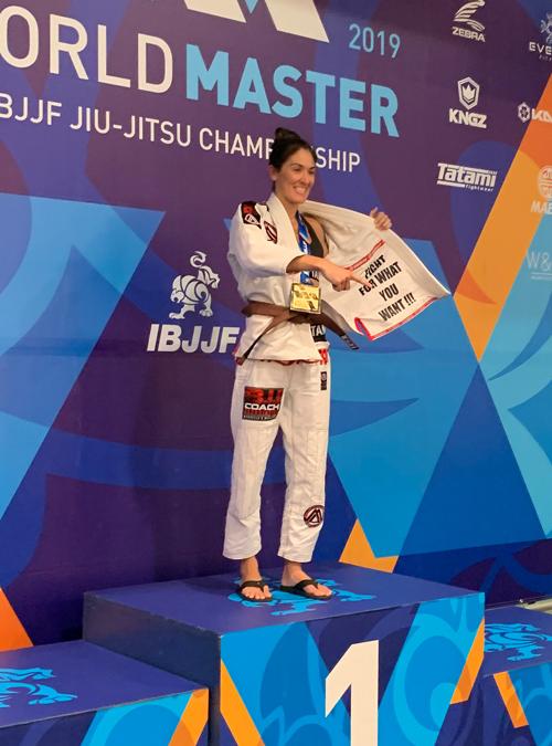 Brianne Corral on the podium after winning IBJJF World Master 2019