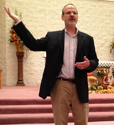 Popular Catholic Speaker Gary Zimak informing a parish audience that they can stop worrying with the help of Jesus Christ and His Catholic Church.