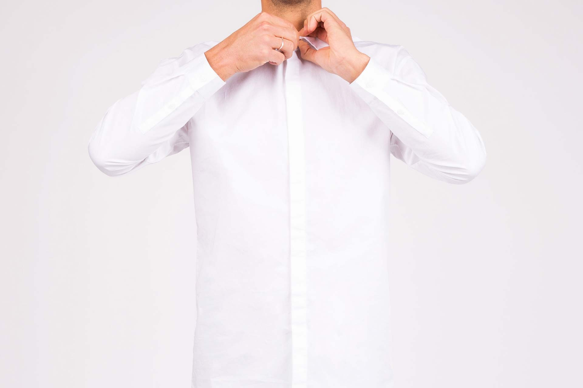 Man wearing freshly pressed dress shirt representing east bay dry cleaning delivery