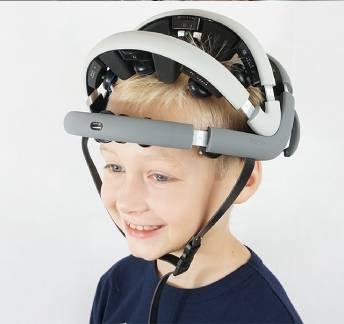 Happy child wearing Zeto Wireless Dry EEG Headset Device