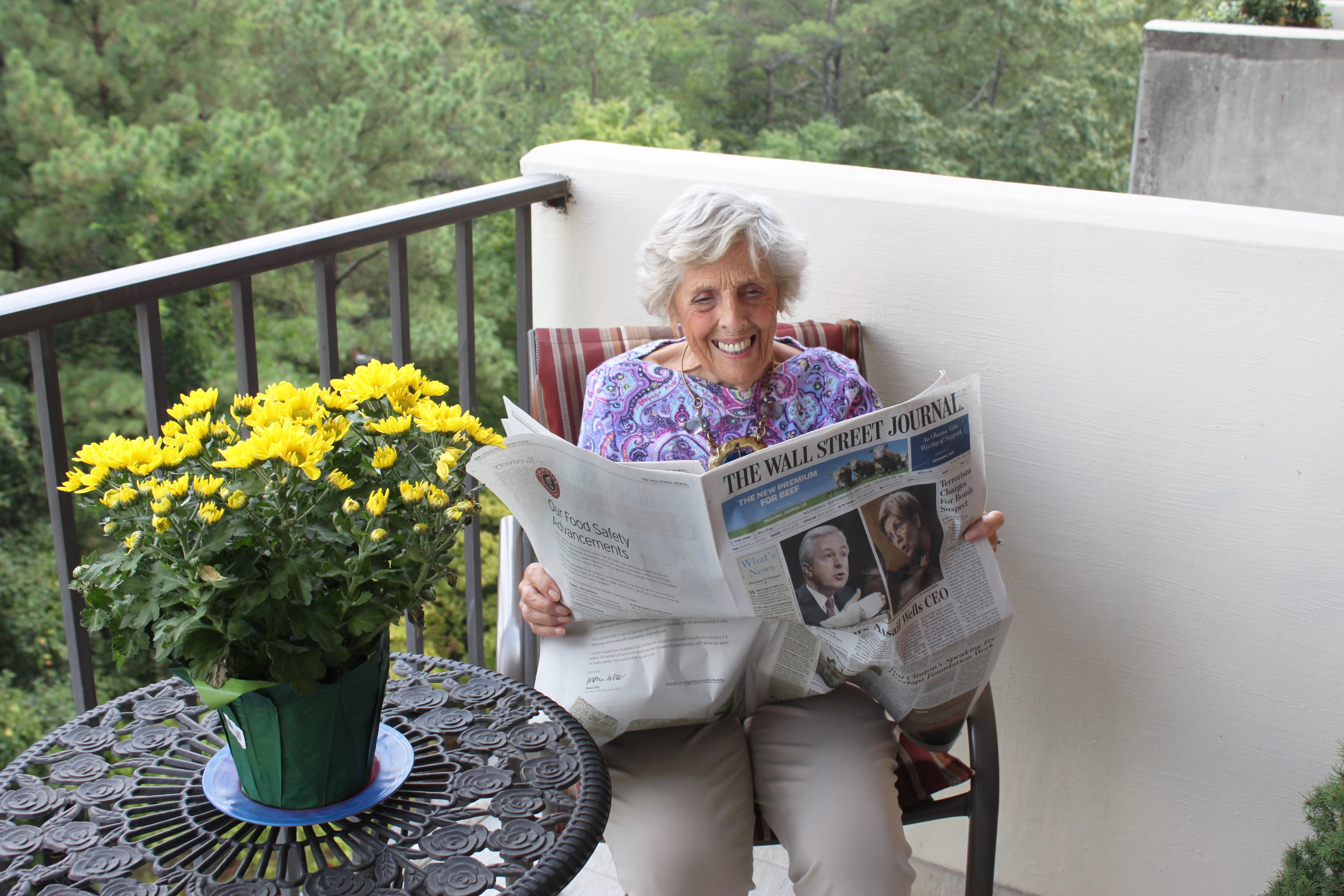 Lady Reading Newspaper on balcony