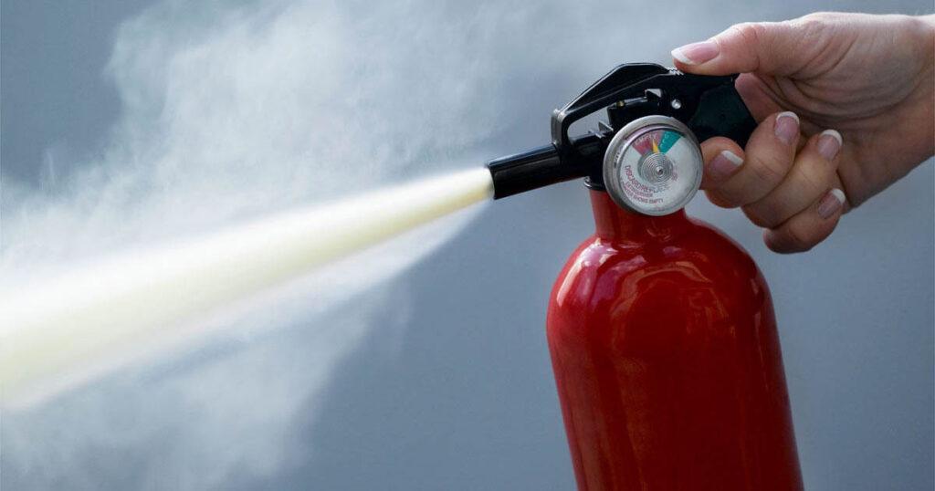 fire extinguisher discharging