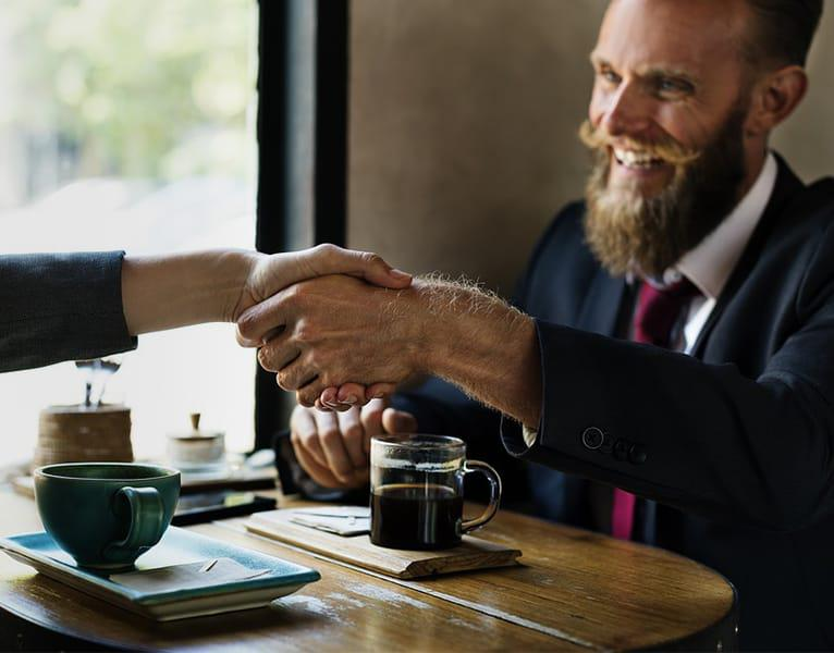 company owner shaking hands