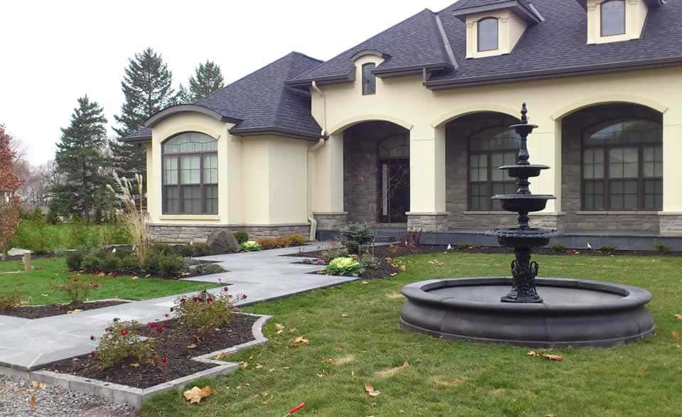 Formal front yard with fountain