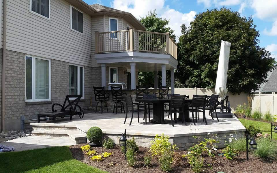 Multi-level patio with balcony and kitchen island