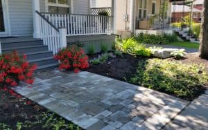 Paved stone walkway and gardens with ornament large lime stones