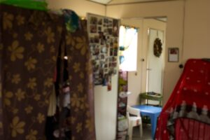 The big cloth thing on the left is our closet and the rid to the right is our home-school supplies. The door is our prayer wall (can you find your picture?)