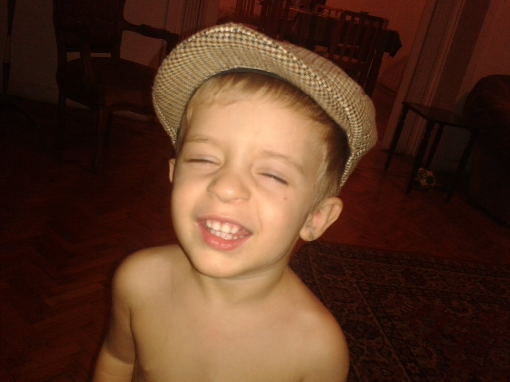 12- a little boy who loves hats, and saying cheese...