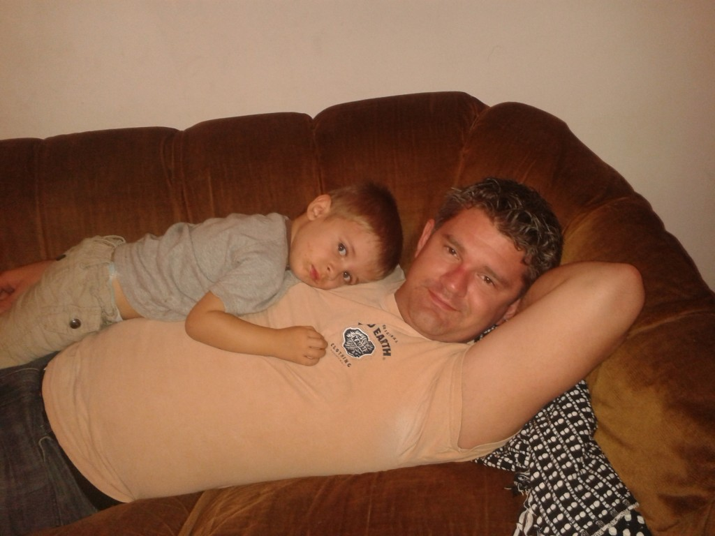19-cuddles with Dad on the couch