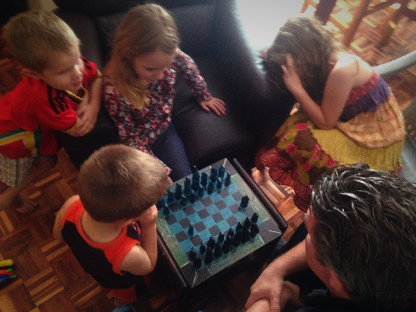 01.16-J-- teaching the kids chess. They love it!