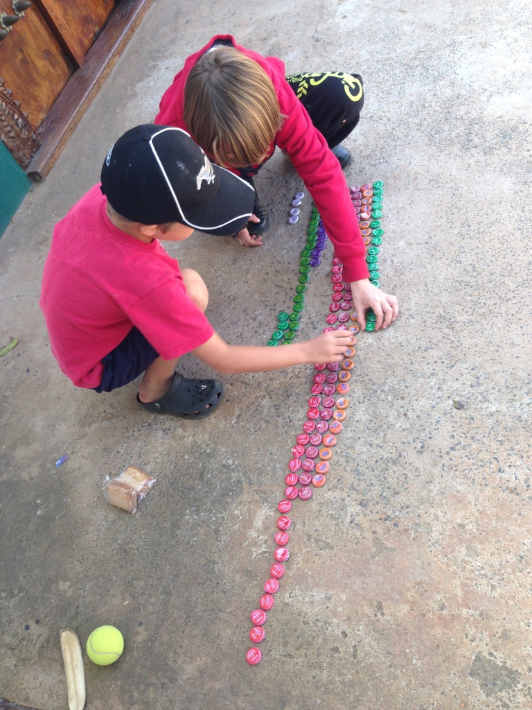 The kids gathered bottle tops all week then lined then up to see what hte winning Soda was...For those that are curious it was Coke followed by Stoney...