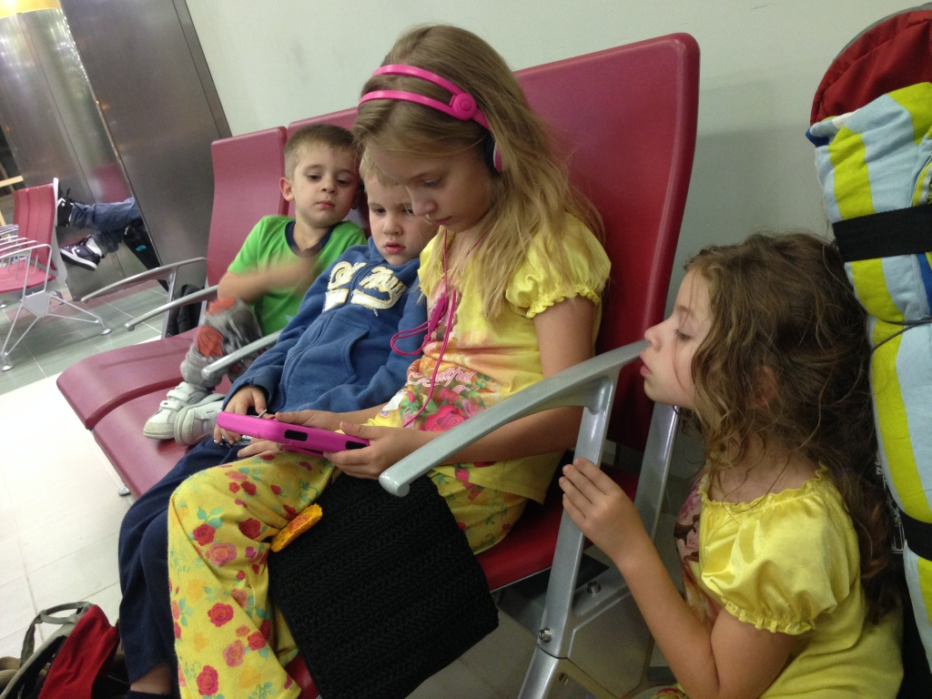 2.22-Waiting for leg one of our 36 hour flight to our passport country...these tired four were so good!