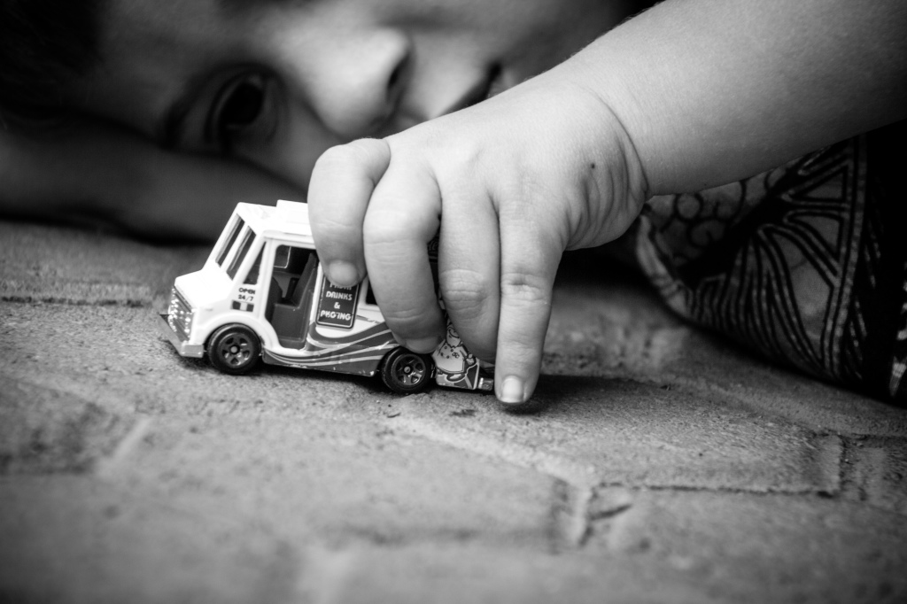 """I challenged myself this week to get an """"everyday"""" shot or activity from a new angle and this was the result. My little man in his element making his car come to life. It took work to lie on the floor but overcoming laziness was worth it."""