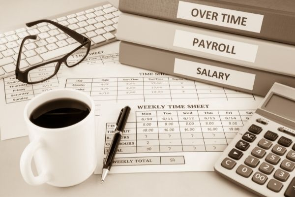 files showing overtime, payroll and salary | payroll outsourcing australia | Numera