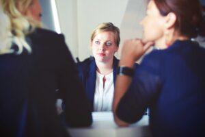 Women negotiating at a table
