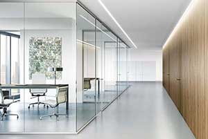 An image showing a interior glass wall used an an office setting