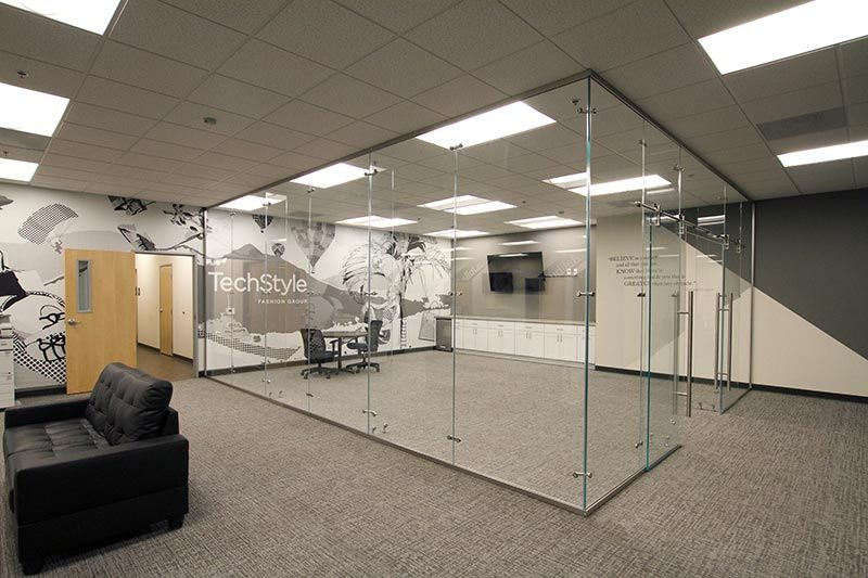 Image showing our glass partition system utilized in an office settings