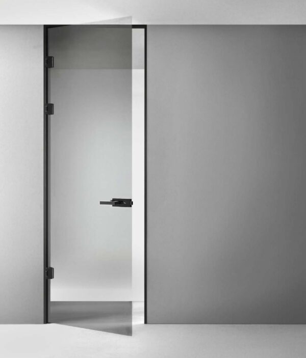 image shows a glass swing door with black anodized stainless steel hardware