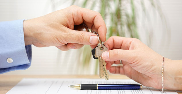 person giving keys to another person