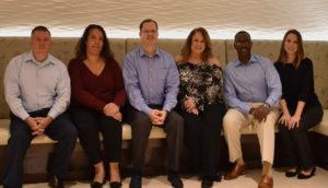 supreme lending executives sitting together
